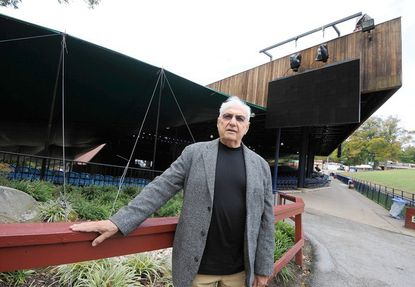 Architect Frank Gehry visits buildingsin Columbia he designed several decades ago, including Merriweather Post Pavilion in the background.