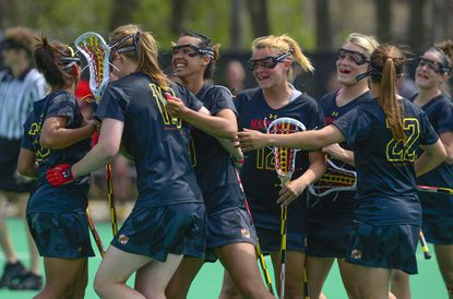 Camilla Hayes (19) is congratulated by teammates after scoring the Terps' final goal.