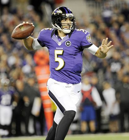 Quarterback Joe Flacco throws under pressure during the first half of the Ravens' Sunday night game against the New England Patriots at M&T Bank Stadium in Baltimore.