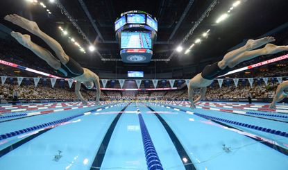 Michael Phelps, left, and Ryan Lochte start the men's 200-meter individual medley at the U.S. Olympic swimming trials, Friday, July 1, 2016, in Omaha, Neb.