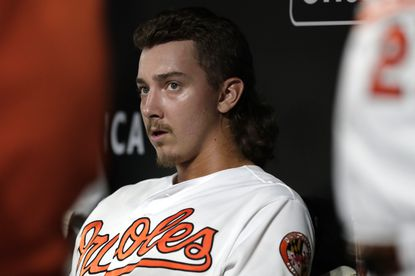 Baltimore Orioles relief pitcher Hunter Harvey sits in the dugout after pitching to the Kansas City Royals during the eighth inning of a baseball game, Tuesday, Aug. 20, 2019, in Baltimore. The Orioles won 4-1. (AP Photo/Julio Cortez)