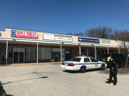 Baltimore County police canvass a Rosedale shopping center after 13-year-old Rickie Forehand was fatally shot in the parking lot late Saturday night.