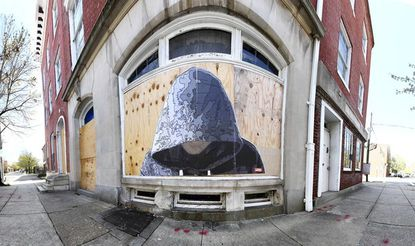 Baltimore street artist Justin Nether composed this mural, depicting Trayvon Martin, at East Baltimore and Caroline streets.