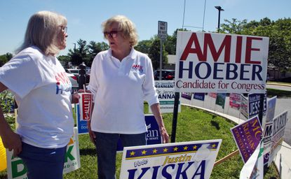 Amie Hoeber, right, the Republican nominee in Maryland's 6th Congressional District, talks to a supporter at an early voting center in Frederick in June.