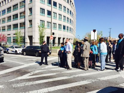 BUILD Baltimore outside the police headquarters, requesting a meeting with Police Commissioner Anthony Batts.