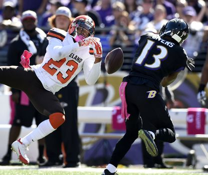 Cleveland Browns defensive back Joe Haden (23) cannot hang onto a long Joe Flacco (5) pass intended for Ravens wide receiver Chris Givens in the second quarter.