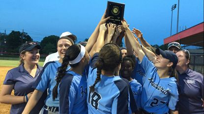 The Howard softball team raises the 4A North regional championship plaque after beating Montgomery Blair, 2-0, on Monday, May 21.