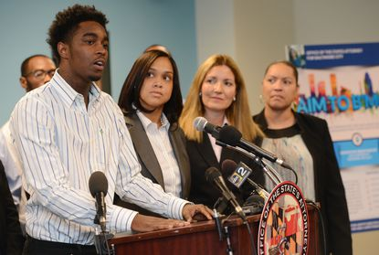 Shyheim Holly, 19, talks about making mistakes and the chance he will get through State's Attorney Marilyn Mosby's Aim To B'More program. Listening, from left,are Mosby, Deborah Spector, deputy director of crime control and prevention for Mosby's office, and Holly's mother, Shanee Myers, 50.