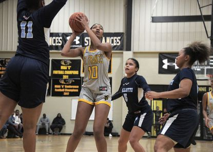 St. Vincent Pallotti Panthers' Larri Sydnor (11), Tahlia Stangerlin (5) and Jania Hall surround St. Frances Panthers forward Angel Reese (10), who still scores a basket during a key matchup Fri., Jan. 24, 2020. (Karl Merton Ferron/Baltimore Sun Staff)