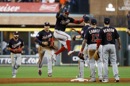 Washington Nationals celebrate after their win against the Houston Astros in Game 1 of the baseball World Series Tuesday, Oct. 22, 2019, in Houston. The Nationals won 5-4 to take a 1-0 lead in the series. (AP Photo/Matt Slocum)