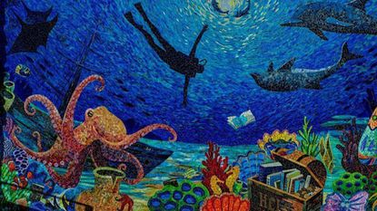 Yulia Hanansen created the new Elkridge Branch library mural that was revealed on Oct. 20.