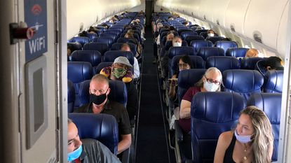 Masked passengers fill a Southwest Airlines flight from Burbank, California, to Las Vegas on June 3, 2020, with middle seats left open.
