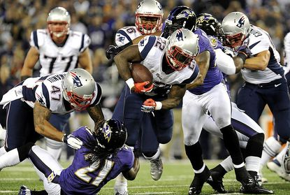 Patriots running back Steven Ridley drives against the Ravens during the first half of their Sunday night game against the New England Patriots at M&T Bank Stadium in Baltimore.
