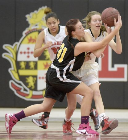 Dulaney junior forward Lydia Naughton, right, was a solid contributor for the Lions last year, averaging eight points and six rebounds per game.