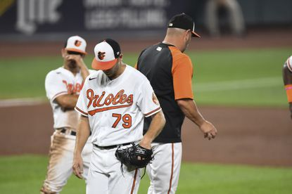 Baltimore Orioles relief pitcher Konner Wade (79) is removed from the game by s manager Brandon Hyde during the fourth inning of a baseball game against the Los Angeles Angels, Tuesday, Aug. 24, 2021, in Baltimore. The O's lost the game that night, their 19th loss in a row. (AP Photo/Terrance Williams)