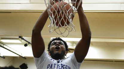 Patterson's Marvin Price, dunking in a game earlier this season against Dunbar, scored 33 points Saturday against Lake Clifton.