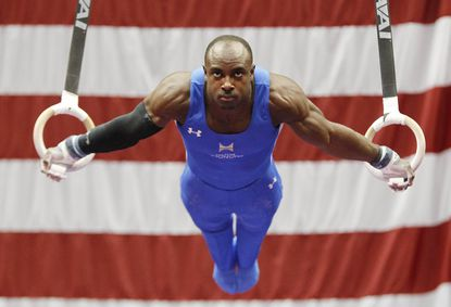 Donnell Whittenburg competes on the rings at the 2014 P&G Championships at the CONSOL Energy Center.