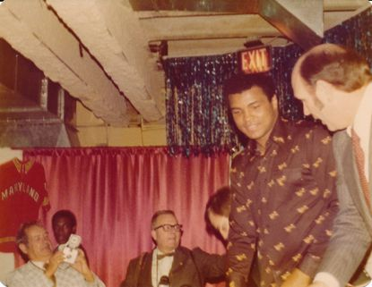 Muhammad Ali shown at a hotel in April 1976 in a hotel in Maryland where he spoke at the Terps basketball team's end-of-seaosn banquet.