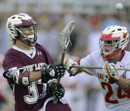 Boys' Latin's Tally Bruno fires a shot past Calvert Hall's Stephen Kelly in the second half.