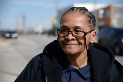 April Matthews of Park Heights waits for the No. 3 bus after getting off work from her job at a Days Inn. Her bus commute takes her two hours each way, but she plans to use a $3,000 earned income tax credit to buy a car.