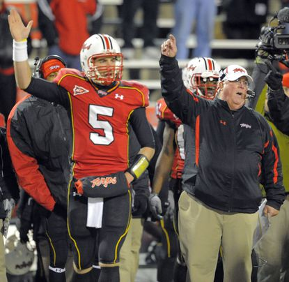 Former Terps quarterback Danny O'Brien and coach Ralph Friedgen motion for a first down in a 2010 win against North Carolina State.