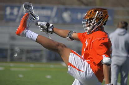 McDonogh midfielder Dante Trader Jr. stretches at St. Mary's Field at Pascal Sports Complex on March 30, 2021.