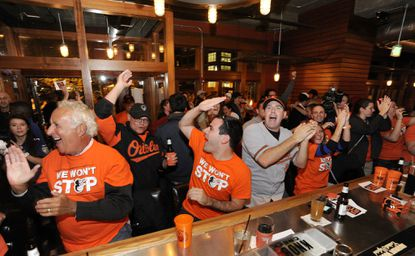 Orioles fanscelebrate the Baltimore Orioles' win against the Detroit Tigers during the 2014 American League Division Series at Bond Street Social in Fells Point.