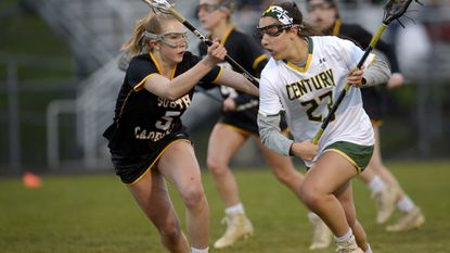 Century's Demma Hall drives the ball while covered by South Carroll's Shannon Finch during the second half of the Cavaliers' 9-7 win over Century in Eldersburg Tuesday, April 17, 2018.