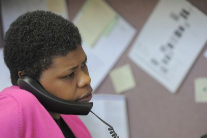 Cassaundra Jackson of the Better Business Bureau of Greater Maryland works on a complaint.