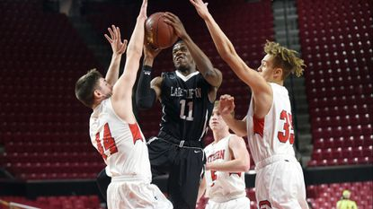 Lake Clifton's Armon Harried, center, scored 35 points in the state title game.