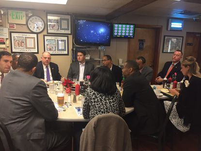 Republican Gov. Larry Hogan met with seven incoming members of the Baltimore City Council at Jimmy's Restaurant in Fells Point.