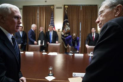 Vice President Mike Pence, left speaks with, Sen. Chuck Grassley, R-Iowa, right, as they arrive for a meeting in the Cabinet Room of the White House, in Washington, Feb. 28, 2018, with President Donald Trump and members of congress to discuss school and community safety.