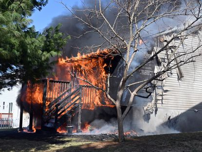 The back side of the house was fully engulfed. Firefighters respond to a house fire on the 10 block of Upman Court in Catonsville.