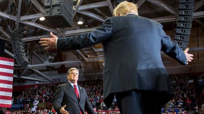 President Donald Trump greets Fox News talk show host Sean Hannity at a Make America Great Again rally in Cape Girardeau, Missouri, Monday night.