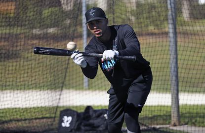 Miami Marlins outfielder Victor Victor Mesa runs drills before an exhibition spring training baseball game against the Atlanta Braves, in Jupiter, Fla., Wednesday, March 6, 2019.