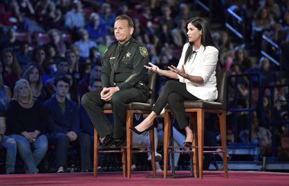 National Rifle Association spokesperson Dana Loesch answers a question while sitting next to Broward Sheriff Scott Israel during a CNN town hall meeting, Wednesday, February 21, 2018, at the BB&T Center, in Sunrise, Florida.