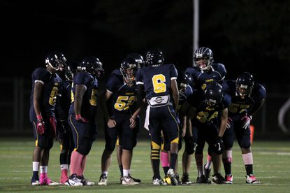 Catonsville quarterback Aaron Jones huddles his team together in a game against Eastern Tech in 2011 during the Comets' 12-game winning streak.