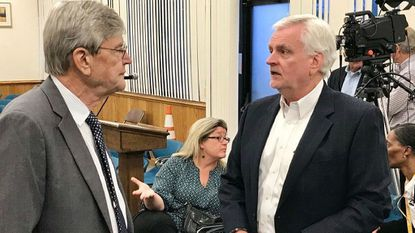 Randy Nungester, right, general manager for Armstrong Utilities, speaks with Harford County Council Attorney Charles Kearney following a June 4 public hearing on council Bill 19-017, establishing a 15-year cable franchise agreement for Armstrong.