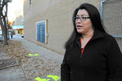 Laura Arvizu, Baltimore, talks about the city's Safe Routes to School program after driving her son to the Wolfe Street Academy.