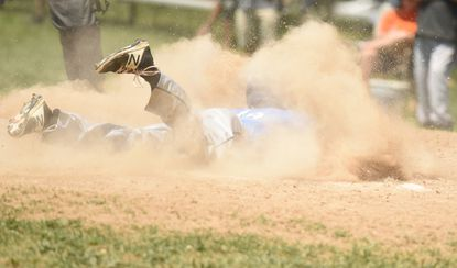 A Howard baseball player slides into home against Dulaney in the 4A North region final last season. The Lions eventually lost in the state championship, and they are hoping to replicate that deep postseason run this spring.