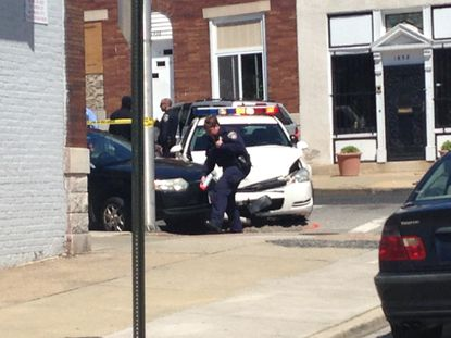 Police investigate an officer-involved crash in East Baltimore.