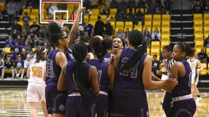 Pikesville girls celebrate their win in the Class 1A state basketball championship game against Smithsburg at Towson SECU arena.