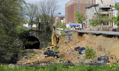 Baltimore, MD--May 1, 2014--This is the scene, photographed from the St. Paul Street side, of the aftermath of a landslide which occurred Wednesday on 26th street between St. Paul and Charles Streets. Crews are on the scene removing debris and vehicles from the site. staff photo/Barbara Haddock Taylor