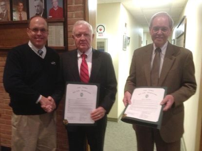 Bel Air Town Commissioner David Carey, left, congratulates Bill Cox, current chairman of the Greater Bel Air Community Foundation, center, and founding chairman Don Young. Both men received a proclamation from the Bel Air Town Commissioners Monday for their work with the foundation.