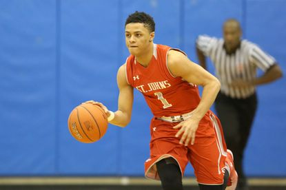 Anthony Cowan Jr. of St. John's (D.C.) dribbles up court while playing in the Big Apple Basketball Classic earlier this month.