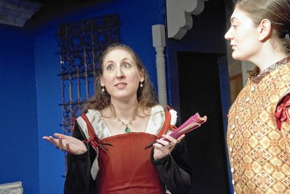 """Laurie Simonds as Olivia and Stevie Miller as Cesario in William Shakespeare's """"Twelfth Night,"""" at Laurel Mill Playhouse."""