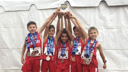 The Eldersburg Rogue Runners Arrows 9-10 boys team holding its second-place award at the AAU Nationals in Tennessee. From left, Dario Lavelle, Jeremiah McGuire, Nicolas Avalos Restrepo, Sebastian Avalos Restrepo, Nathan Frattali.
