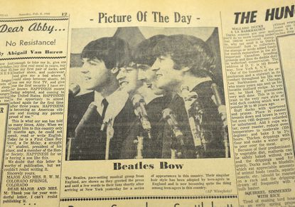A photo and cartoon of The Beatles appeared in The Evening Capital February 8, 1964.