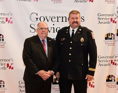 Linas Saurusaitis, Emergency Medical Services Captain at the Baltimore Washington International Thurgood Marshall Airport Fire Rescue Department, receives a Governor's Service Award from Gov. Larry Hogan on Oct. 21, 2019.