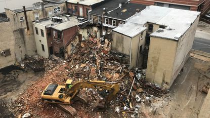 A strip of commercial row houses in the 300 block of N. Calvert Street is being razed by owner Mercy Medical Center for parking in the short-term and eventually an expansion of its medical campus.